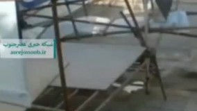 سقوط داربست یک ستاد تبلیغاتی روی شهروندان در آبادان